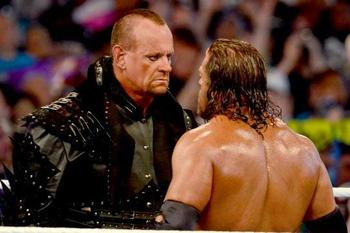 The Undertaker and Triple H square off at WrestleMania 28. (Courtesy of WWE.com)