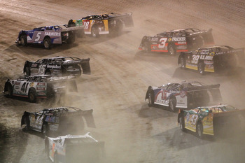 ROSSBURG, OH - JUNE 06: Kasey Kahne, driver of the #5 Farmers Insurance Chevrolet, leads the field on a restart during the Feed the Children Prelude to the Dream at Eldora Speedway on June 6, 2012 in Rossburg, Ohio.  (Photo by Tyler Barrick/Getty Images f