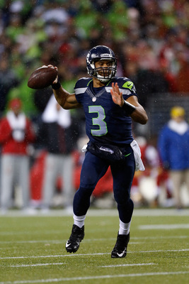 SEATTLE, WA - DECEMBER 23:  Russell Wilson #3 of the Seattle Seahawks looks to pass against the San Francisco 49ers at Qwest Field on December 23, 2012 in Seattle, Washington.  (Photo by Otto Greule Jr/Getty Images)