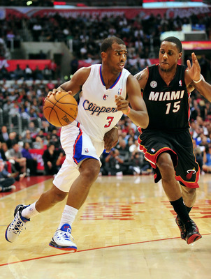 November 14, 2012; Los Angeles, CA, USA; Los Angeles Clippers point guard Chris Paul (3) moves the ball against the defense of Miami Heat point guard Mario Chalmers (15) during the second half at Staples Center. Mandatory Credit: Gary A. Vasquez-USA TODAY