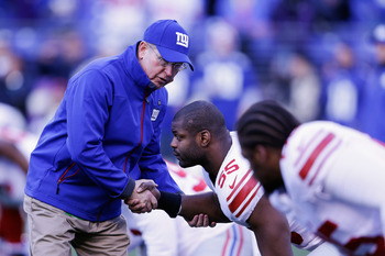 Tom Coughlin sharing a pregame handshake and pep talk with linebacker Keith Rivers.