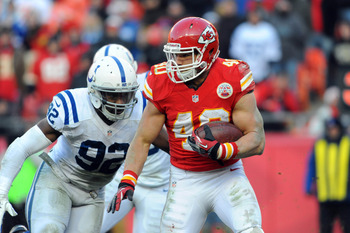 December 23, 2012; Kansas City, MO, USA; Kansas City Chiefs running back Peyton Hillis (40) runs the ball and is chased by Indianapolis Colts outside linebacker Jerry Hughes (92) in the second half at Arrowhead Stadium. The Colts won 20-13. Mandatory Cred