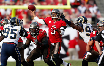 TAMPA, FL - DECEMBER 23: Quarterback Josh Freeman #5 of the Tampa Bay Buccaneers throws a pass against the St. Louis Rams during the game at Raymond James Stadium on December 23, 2012 in Tampa, Florida. (Photo by J. Meric/Getty Images)