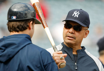 ANAHEIM, CA - OCTOBER 19:  Hall of Famer Reggie Jackson (R) talks to Nick Swisher #33 of the New York Yankees during batting practice prior to the start of Game Three of the ALCS against the Los Angeles Angels of Anaheim during the 2009 MLB Playoffs at An