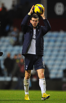 Gareth Bale collects the match ball after his hat-trick for Spurs at Aston Villa.
