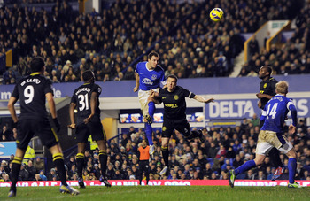 Phil Jagielka heads home the winner for Everton against Wigan.