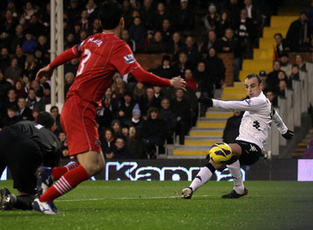 Fulham striker Dimitar Berbatov slots home against Southampton.