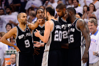 OKLAHOMA CITY, OK - JUNE 06:  Tony Parker #9 of the San Antonio Spurs talks with teammates Kawhi Leonard #2, Manu Ginobili #20, Tim Duncan #21 and DeJuan Blair #45 of the San Antonio Spurs against the Oklahoma City Thunder in Game Six of the Western Confe