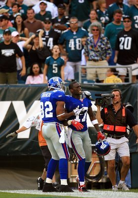 WR Plaxico Burress capped off the Giants' incredible comeback victory over Philly in '06 with a TD grab in OT.