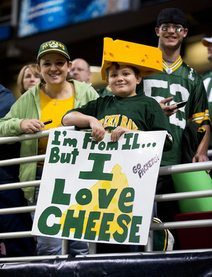 ST. LOUIS, MO - OCTOBER 21: A young Green Bay Packers fan watches the pregame activities prior to the game between the Green Bay Packers and St. Louis Rams at the Edward Jones Dome on October 21, 2012 in St. Louis, Missouri.  (Photo by David Welker/Getty