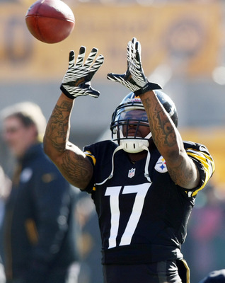 Dec 23, 2012; Pittsburgh, PA, USA; Pittsburgh Steelers wide receiver Mike Wallace (17) catches a pass during warm-ups before the game against the Cincinnati Bengals at Heinz Field. Mandatory Credit: Jason Bridge-USA TODAY Sports