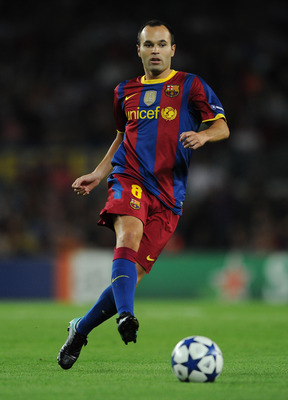 BARCELONA, SPAIN - SEPTEMBER 14:  Andres Iniesta of Barcelona passes the ball during the UEFA Champions League group D match between Barcelona and Panathinaikos on September 14, 2010 in Barcelona, Spain. Barcelona won the match 5-1.  (Photo by Jasper Juin