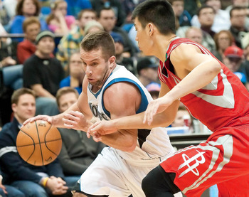 Dec 26, 2012; Minneapolis, MN, USA; Minnesota Timberwolves point guard Jose Juan Barea (11) dribbles against Houston Rockets point guard Jeremy Lin (7) in the fourth quarter at Target Center. Rockets won 87-84. Mandatory Credit:  Greg Smith-USA TODAY Spor