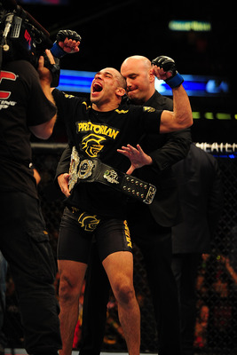 Jul 21, 2012; Calgary, AB, CANADA; Renan Barao celebrates defeating Urijah Faber (not pictured) in the interim bantamweight title bout of UFC 149 at the Scotiabank Saddledome. Mandatory Credit: Anne-Marie Sorvin-USA TODAY Sports