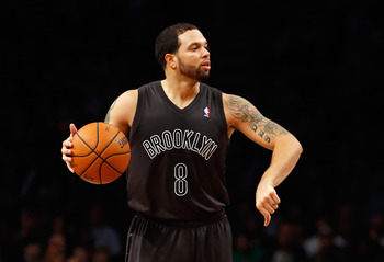 NEW YORK, NY - DECEMBER 25:  Deron Williams #8 of the Brooklyn Nets signals against the Boston Celtics at the Barclays Center on December 25, 2012 in the Brooklyn borough of New York City. NOTE TO USER: User expressly acknowledges and agrees that, by down