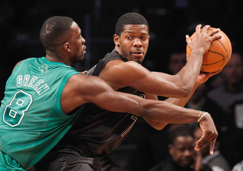 NEW YORK, NY - DECEMBER 25:  Jeff Green #8 of the Boston Celtics defends against Joe Johnson #7 of the Brooklyn Nets at the Barclays Center on December 25, 2012 in the Brooklyn borough of New York City. NOTE TO USER: User expressly acknowledges and agrees