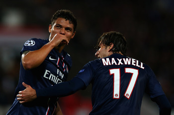 PARIS, FRANCE - SEPTEMBER 18:  Thiago Silva (#2) of Paris Saint-Germain celebrates scoring the second goal of the game with team mate Maxwell during the UEFA Champions League match between Paris Saint-Germain FC and FC Dynamo Kiev at Parc des Princes on S