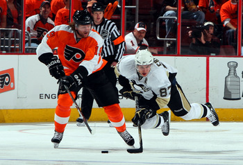 Scott Hartnell working the puck away from Sidney Crosby.