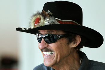 DAYTONA BEACH, FL - FEBRUARY 18:  Team owner Richard Petty looks on in the garage during practice for the NASCAR Sprint Cup Series Daytona 500 at Daytona International Speedway on February 18, 2012 in Daytona Beach, Florida.  (Photo by Jamie Squire/Getty