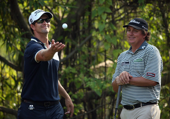 A rare smile on the course from Jason Dufner (right).