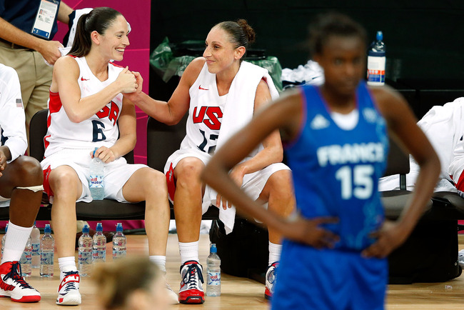 LONDON, ENGLAND - AUGUST 11:  Sue Bird #6 and Diana Taurasi #12 of United States celebrate late in the fourth quarter against France during the Women's Basketball Gold Medal game on Day 15 of the London 2012 Olympic Games at North Greenwich Arena on Augus