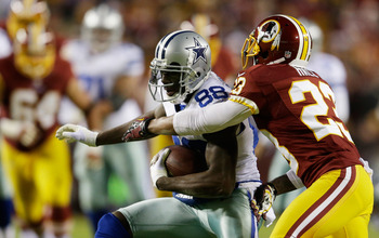 LANDOVER, MD - DECEMBER 30:  Dez Bryant #88 of the Dallas Cowboys is tackled by DeAngelo Hall #23 of the Washington Redskins after a pass reception in the second quarter at FedExField on December 30, 2012 in Landover, Maryland.  (Photo by Rob Carr/Getty I