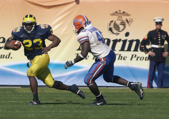 Michigan's Chris Perry eludes a tackler in the 2003 victory over Florida