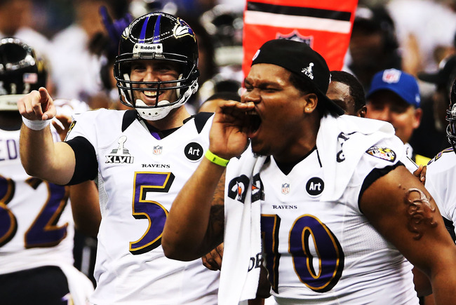 NEW ORLEANS, LA - FEBRUARY 03:  (L-R) Joe Flacco #5 and Ramon Harewood #70 of the Baltimore Ravens celebrate after Jacoby Jones #12 scored on a 108-yard kick-off return touchdown in the third quarter against the San Francisco 49ers during Super Bowl XLVII