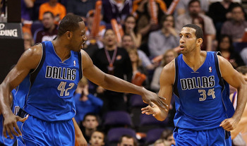 PHOENIX, AZ - DECEMBER 06:  Elton Brand #42 and Brandan Wright #34 of the Dallas Mavericks high five after scoring against the Phoenix Suns during the NBA game at US Airways Center on December 6, 2012 in Phoenix, Arizona. The Mavericks defeated the Suns 9