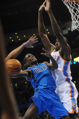 Dec 27, 2012; Oklahoma City, OK, USA; Dallas Mavericks guard Darren Collison (left) attempts a shot against Oklahoma City Thunder forward Serge Ibaka (right) during the first half at the Chesapeake Energy Arena.  Mandatory Credit: Mark D. Smith-USA TODAY