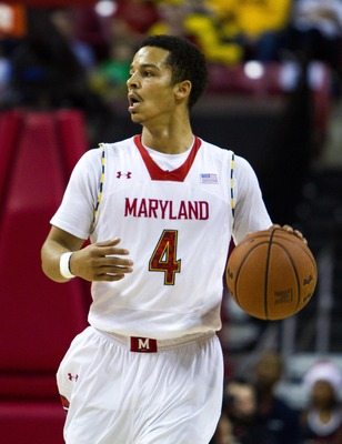 Dec 21, 2012; College Park, MD, USA; Maryland Terrapins guard Seth Allen (4) sets up the offense during the second half at the Comcast Center against the Stony Brook Seawolves. Mandatory Credit: Paul Frederiksen-USA TODAY Sports