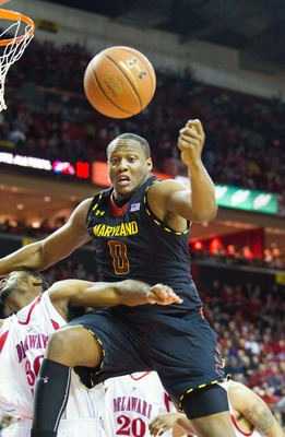 Dec 29, 2012; College Park, MD, USA; Maryland Terrapins forward Charles Mitchell (0) pushes himself off of Delaware State Hornets guard Jordan Lawson (30) towards the ball during the second half at Comcast Center. Mandatory Credit: Paul Frederiksen-USA TO