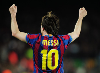 Messi celebrates scoring during a UEFA Champions League match against Arsenal in 2010.