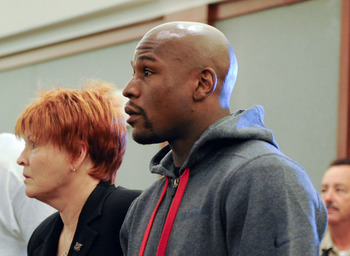 Floyd Mayweather stands next to his lawyer in the courthouse as he gets ready to turn himself in.