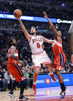 Dec 29, 2012; Chicago, IL, USA; Chicago Bulls shooting guard Marco Belinelli (8) shoots the ball against Washington Wizards shooting guard Bradley Beal (3) during the second half at the United Center. Chicago defeats Washington 87-77. Mandatory Credit: Mi