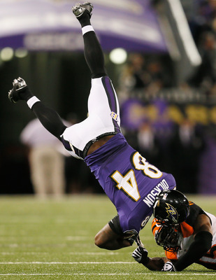 BALTIMORE, MD - SEPTEMBER 10: Defensive back Jeromy Miles #45 of the Cincinnati Bengals tackles tight end Ed Dickson #84 of the Baltimore Ravens after making a catch during the second half at M&T Bank Stadium on September 10, 2012 in Baltimore, Maryland.