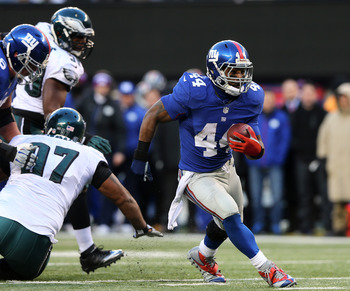 RB Ahmad Bradshaw broke 1,000 yards rushing vs. PHI.