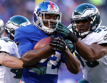 RB David Wilson breaks a tackle vs. PHI.