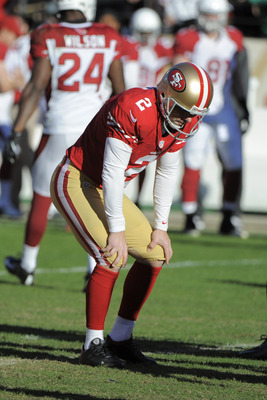 David Akers was shaken up after getting hit on a field-goal attempt.