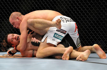 Struve works to submit Gormley at UFC 104