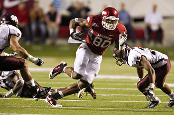 LITTLE ROCK, AR - NOVEMBER 19:   Chris Gragg #80 of the Arkansas Razorbacks runs the ball against the Mississippi State Bulldogs at War Memorial Stadium on November 19, 2011 in Little Rock, Arkansas.  The Razorbacks defeated the Bulldogs  44 to 17.  (Phot