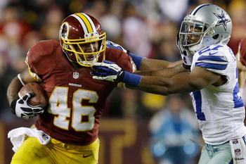 LANDOVER, MD - DECEMBER 30:  Alfred Morris #46 of the Washington Redskins carries the ball against the defense of Eric Frampton #27 of the Dallas Cowboys in the third quarter at FedExField on December 30, 2012 in Landover, Maryland (Photo by Rob Carr/Gett
