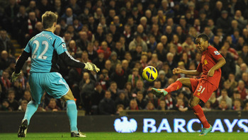 LIVERPOOL, ENGLAND - JANUARY 02:  Raheem Sterling of Liverpool  scores the opening goal past Simon Mignolet of Sunderland during the Barclays Premier League match between Liverpool and Sunderland at Anfield on January 2, 2013 in Liverpool, England.  (Phot