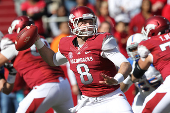 Nov 3, 2012; Fayetteville, AR, USA; Arkansas Razorbacks quarterback Tyler Wilson (8) looks to pass during the game against the Tulsa Golden Hurricanes at Donald W. Reynolds Razorback Stadium. Arkansas defeated Tulsa 19-15. Mandatory Credit: Nelson Chenaul