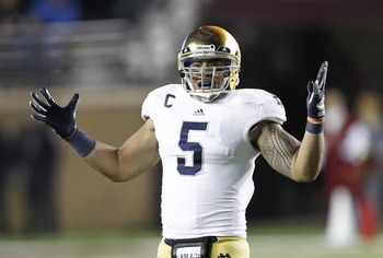 Nov 10, 2012; Boston, MA, USA; Notre Dame Fighting Irish linebacker Manti Te'o (5) reacts during the second half of a game against the Boston College Eagles at Alumni Stadium.  Mandatory Credit: Mark L. Baer-USA TODAY Sports