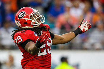 Oct 27, 2012; Jacksonville, FL, USA; Georgia Bulldogs linebacker Jarvis Jones (29) celebrates after a sack in the second half against the Florida Gators at EverBank Field. The Bulldogs won 17-9.  Mandatory Credit: Daniel Shirey-USA TODAY Sports