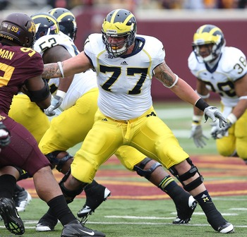 Nov 3, 2012; Minneapolis, MN, USA: Michigan Wolverines offensive linesman Taylor Lewan (77) makes a block in the second half against the Minnesota Golden Gophers at TCF Bank Stadium. Mandatory Credit: Jesse Johnson-USA TODAY Sports