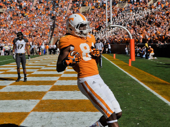Nov 10, 2012; Knoxville, TN, USA; Tennessee Volunteers wide receiver Cordarrelle Patterson (84) scores a touchdown against the Missouri Tigers during the first half at Neyland Stadium. Mandatory Credit: Jim Brown-USA TODAY Sports