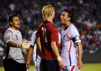 CARSON, CA - SEPTEMBER 02:  Brek Shea #11 of the United States is confronted by Randall Azofeifa #14 of Costa Rica as goalkeeper Keylor Navas #1 attempts to seperate them during the friendly soccer match at The Home Depot Center on September 2, 2011 in Ca