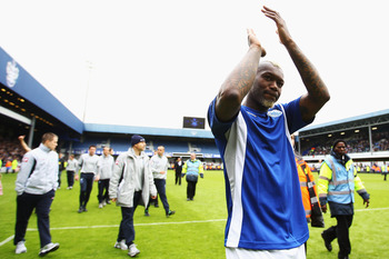 LONDON, ENGLAND - MAY 06:  Djibril Cisse of Queens Park Rangers applauds his sides fans following the Barclays Premier League match between Queens Park Rangers and Stoke City at Loftus Road on May 6, 2012 in London, England.  (Photo by Julian Finney/Getty